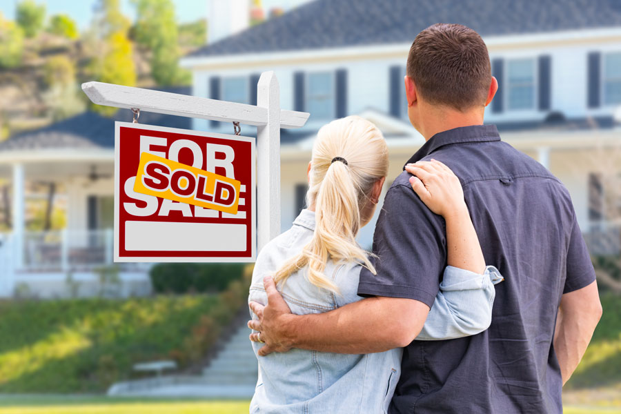 House with Couple and For Sale Sign
